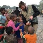 Kids gather around Ben's camera in India